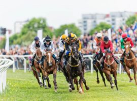 jockeys and horses in action