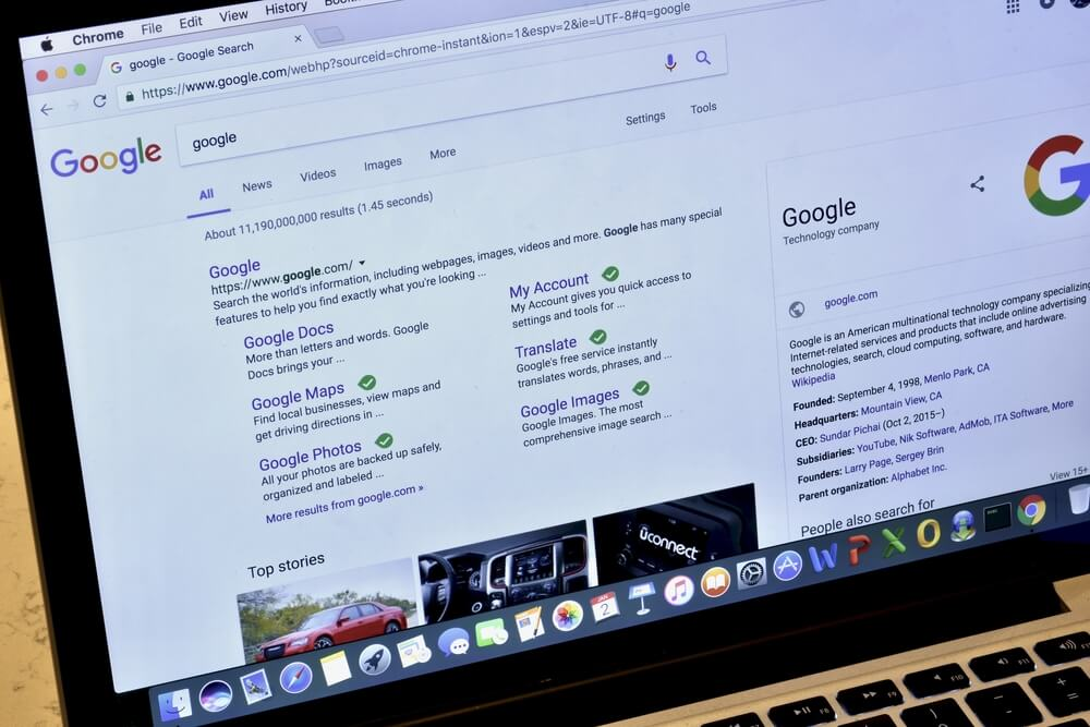 Apple Macbook Pro displaying the Google search engine on its screen