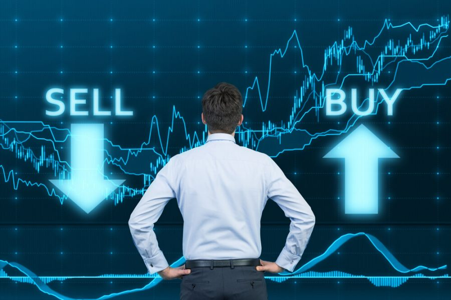 Businessman and the choice 'sell' or 'buy'