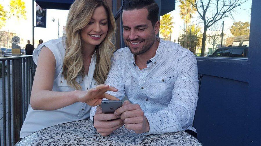 Couple Holding Phone