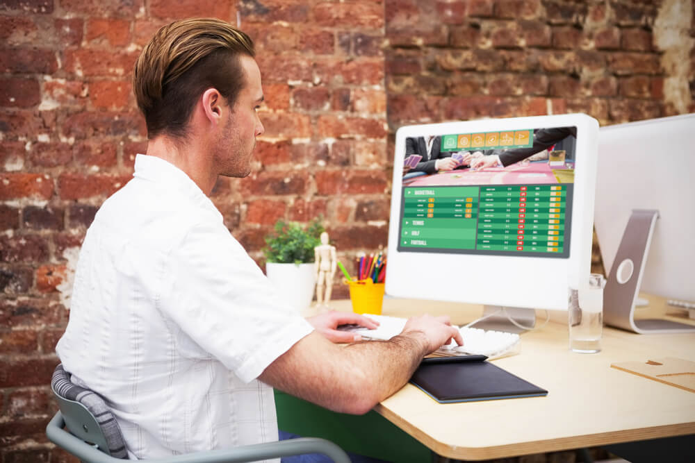 Gambling app screen against creative worker