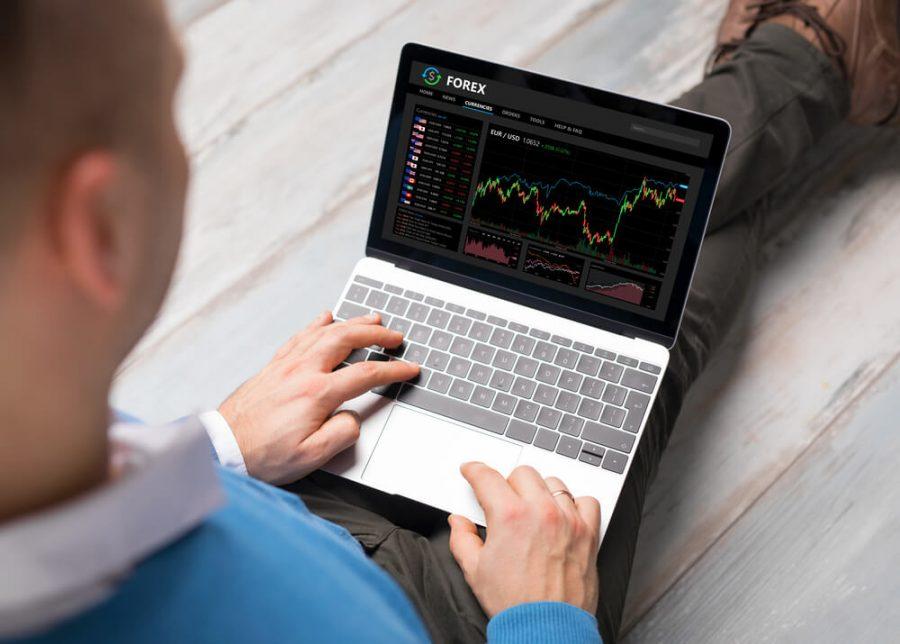 Man using Forex trading software