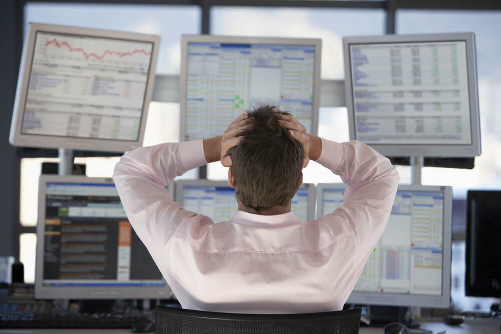 Rear view of stock trader