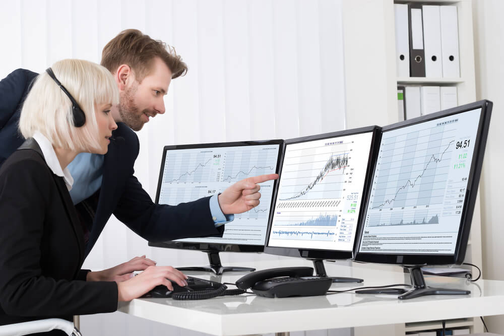 Two Business people Analyzing Stock Charts