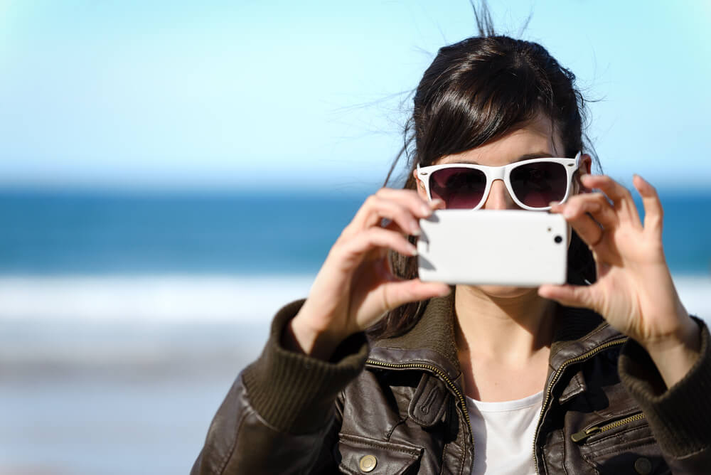 Woman taking photo with cellphone