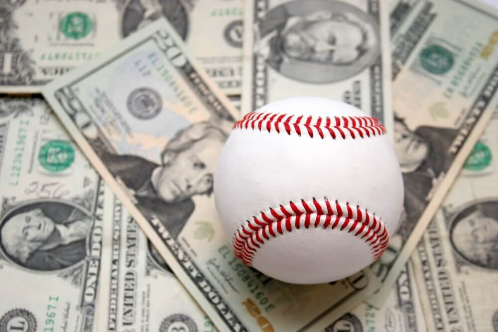 A baseball on money