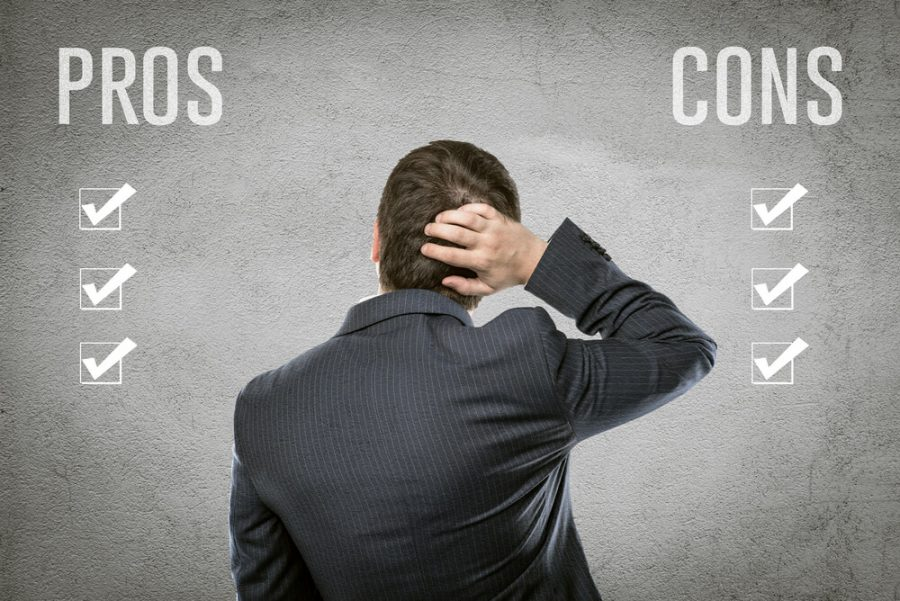 businessman selecting all pros and cons