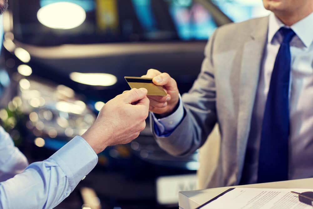 close up of customer giving credit card