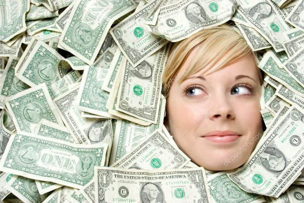 A woman in a pile of money