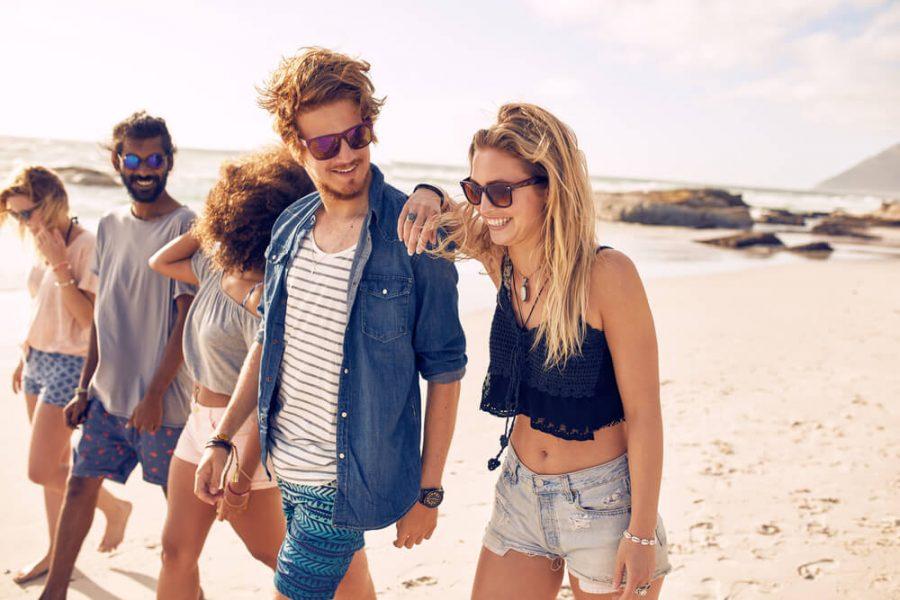 friends having a walk on the beach