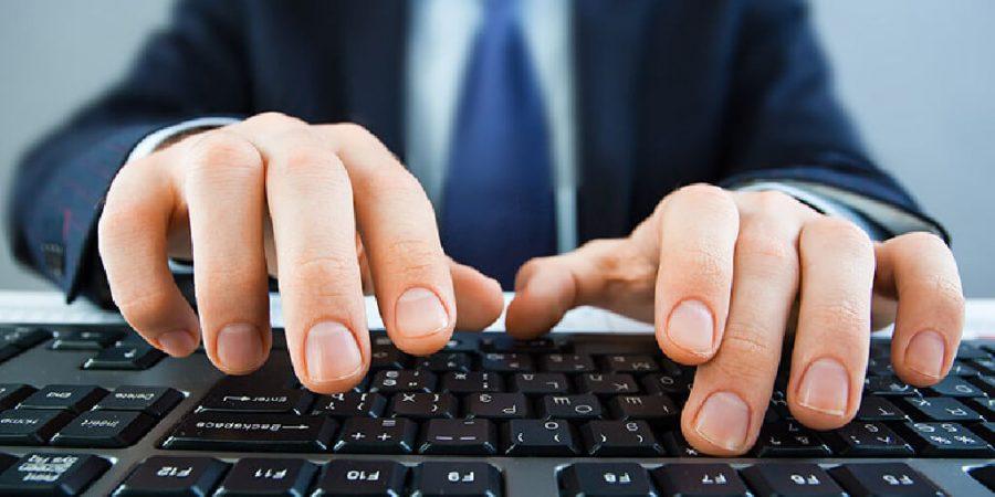 man typing in keyboard