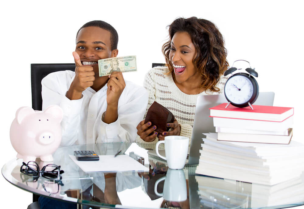 smiling couple excited to pay off debts