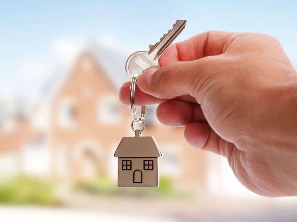A man holding a house key