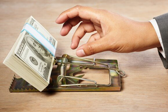 value-trap-mouse-trap-hand-with-money