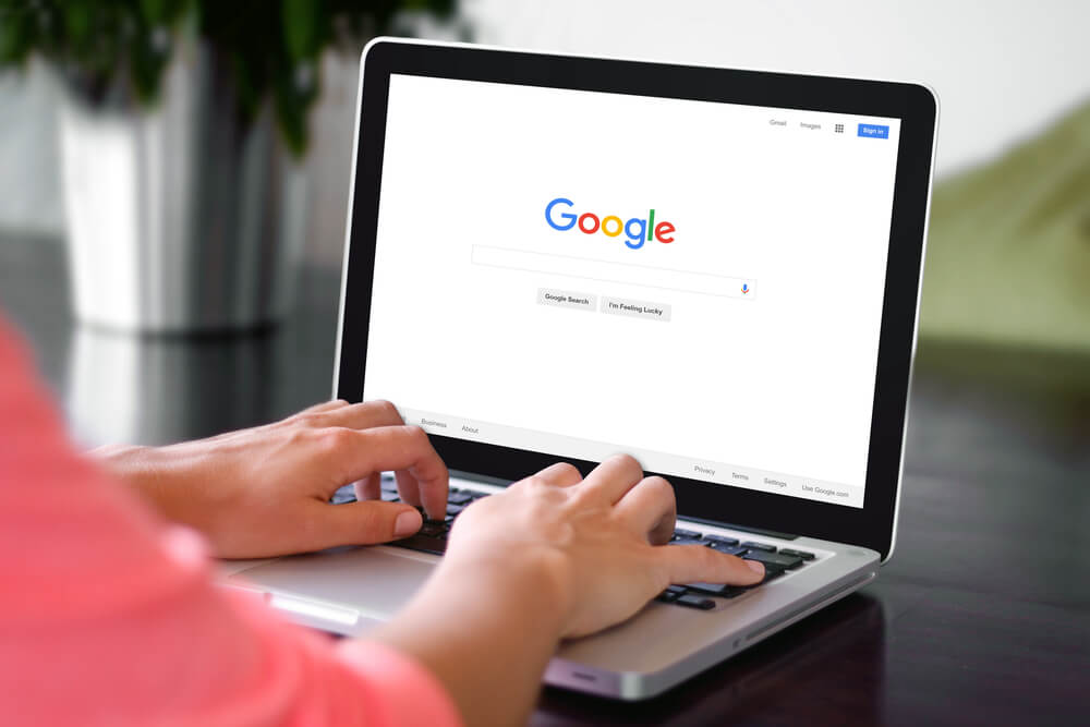 woman using google on laptop